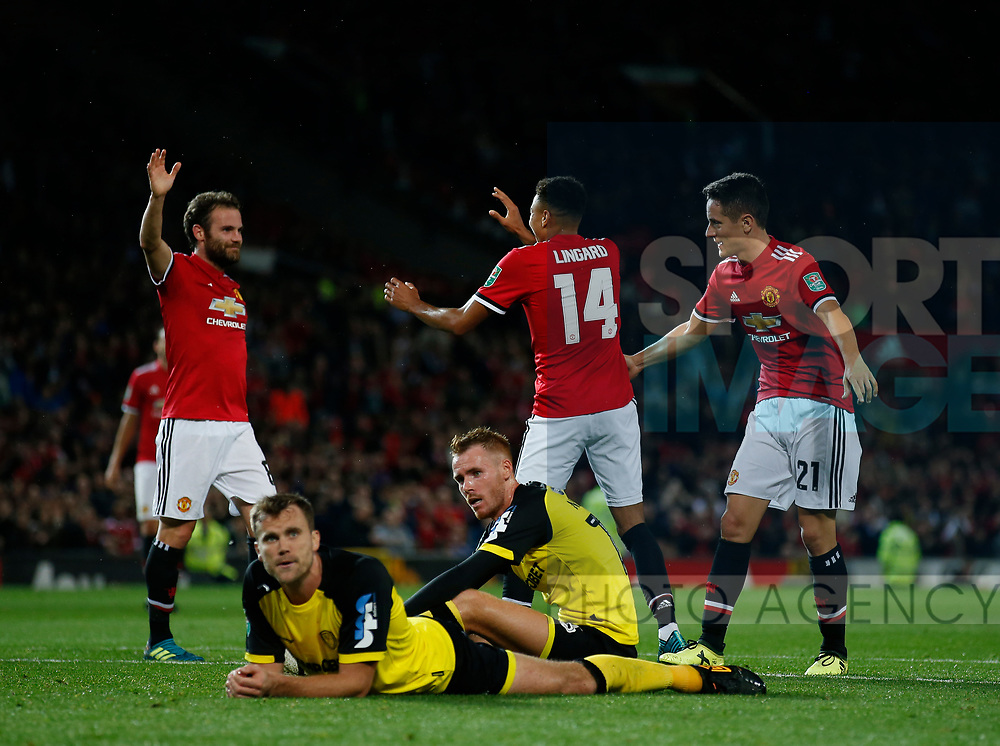 Jesse Lingard of Manchester United celebrates his goal as Burton players sit dejected during the Carabao Cup Third Round match at the Old Trafford Stadium, Manchester. Picture date 20th September 2017. Picture credit should read: Simon Bellis/Sportimage