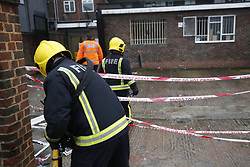 © Licensed to London News Pictures. 04/03/2018. Harold Hill, UK. The scene at the back of a Post Office where emergency services are currently responding to an explosion near a row of shops in Harold Hill, Essex. Nearby homes have been evacuated. Photo credit: Peter Macdiarmid/LNP