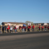 A large group walks six miles from the Navajo Nation Council Chambers in Window Rock, Arizona to Tséhootsooí Middle School in Fort Defiance, Arizona Wednesday in honor of Missing and Murdered Indigenous Persons Awareness Day. Tséhootsooí Middle School was the last place Laverda Guy Sorrell was seen in 2002 when she went missing.