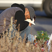 A man cries as he pays his respects to the shrine created under the school sign in Sandy Hook after yesterday's shootings at Sandy Hook Elementary School, Newtown, Connecticut, USA. 15th December 2012. Photo Tim Clayton