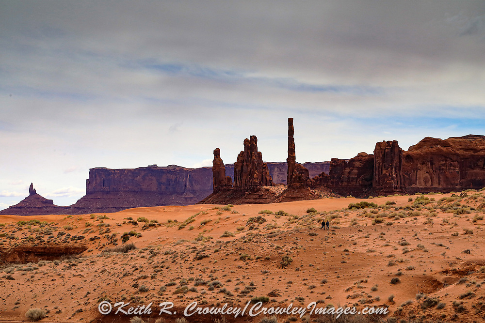 Navajo hikers in Monument Valley.