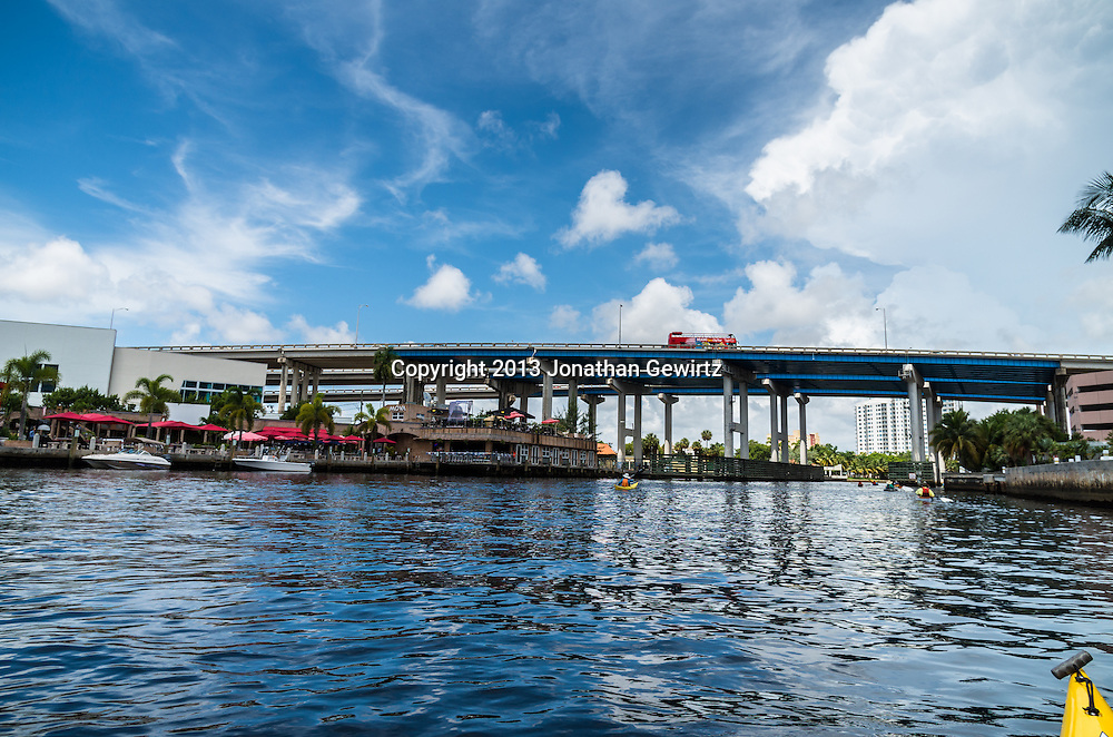 Kayakers paddle under US Route 95 as it passes over the Miami River to the West of downtown Miami, Florida. WATERMARKS WILL NOT APPEAR ON PRINTS OR LICENSED IMAGES.