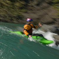 A kayaker enters a rapid on the Kananaskis River in the Canadian Rockies near Calgary, Alberta.