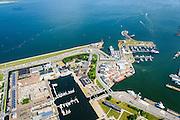 Nederland, Noord-Holland, Den Helder, 05-08-2014; centrum van Den Helder met links rijkswerf Willemsoord (Oude Rijkswerf), nu deels in gebruik als jachthaven. Veerhaven voor de veerboten naar Texel.<br /> Center of Den Helder with former Navy Yard Willemsoord (Old Navy Yard), now partly used as a marina. Ferry port for ferries to Texel. <br /> luchtfoto (toeslag op standard tarieven);<br /> aerial photo (additional fee required);<br /> copyright foto/photo Siebe Swart
