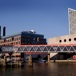 The pedestrian bridge connects two buildings of the Baltimore Aquarium in the Inner Harbor area of the city.  To the left one can see the converted power plant that now hosts ESPN's Sport's Zone and the Hard Rock Cafe, among other retail outlets...Photo by Susana Raab