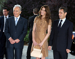 French President Nicolas Sarkozy and first lady Carla Bruni-Sarkozy with Israeli President Shimon Peres during a welcoming ceremony at the Israeli presidential residence in Jerusalem, Israel on June 22, 2008, on the first day of their three-day state visit to Israel and the Palestinian Territories. Photo by Alain Benainous/Pool/ABACAPRESS.COM
