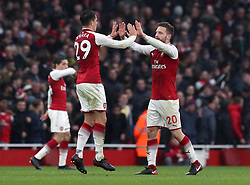 Arsenal's Shkodran Mustafi (right) celebrates scoring his side's first goal of the game with Granit Xhaka during the Premier League match at the Emirates Stadium, London.
