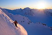 A skier descends the west face of Stone Mountain, outside Valdez, Alaska.