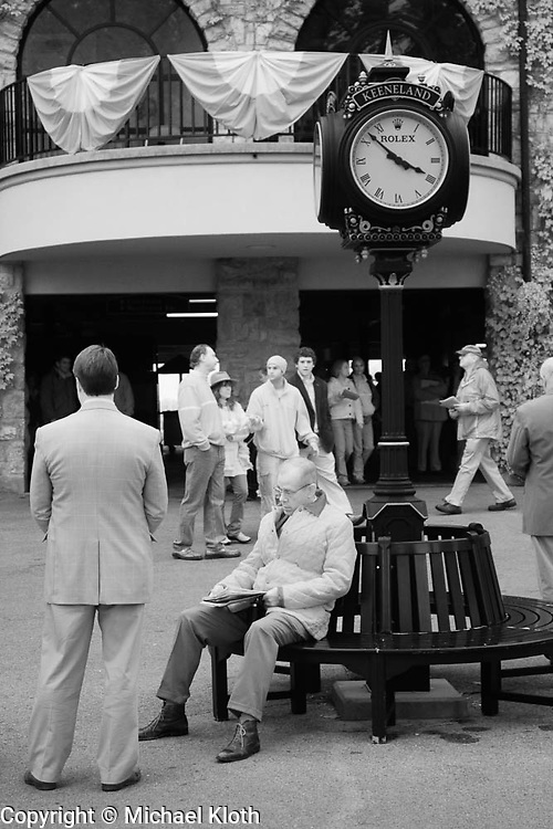 Man in a suit and others prior to a race at Keeneland Race Course, Lexington, KY.  Infrared (IR) photograph by fine art photographer Michael Kloth. Black and white infrared photographs