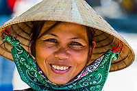 Vietnamese woman wearing Non la (Conical palm leaf hat), Hoi An, Vietnam.
