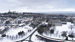 Winter view of Scottish Parliament and Palace of Holyroodhouse at Holyrood in the snow, Edinburgh, Scotland, UK