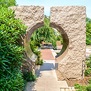 Moongate Garden Smithsonian Castle Gardens Granite Gate. The Moongate Garden, behind the Smithsonian Castle, is modeled on the Temple of Heaven, a Ming Dynasty landscape and structure in Beijing.