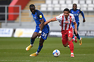 Carlisle United forward Gime Touré (20) and Stevenage defender Luther Wildin (2) battles for possession during the EFL Sky Bet League 2 match between Stevenage and Carlisle United at the Lamex Stadium, Stevenage, England on 20 March 2021.