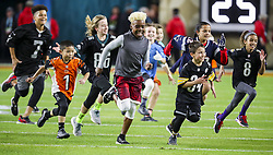 February 2, 2020, Miami Gardens, FL, USA: Children run onto the field before the San Francisco 49ers face off against the Kansas City Chiefs in Super Bowl LIV at Hard Rock Stadium in Miami Gardens, Fla., on Sunday, Feb. 2, 2020. (Credit Image: © TNS via ZUMA Wire)