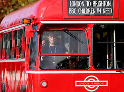 Broadcaster Ken Bruce drives a vintage London bus for BBC Children in Need in the Bonhams London to Brighton Veteran Car Run in Staplefield, Sussex.