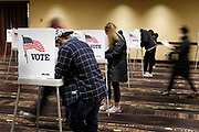 03 NOVEMBER 2020 - WEST DES MOINES, IOWA: A person walks to a voting booth at the Jordan Creek Crossing Event Center on Election Day in West Des Moines. Voter turnout was heavy at most polling places in the Des Moines metro area.       PHOTO BY JACK KURTZ