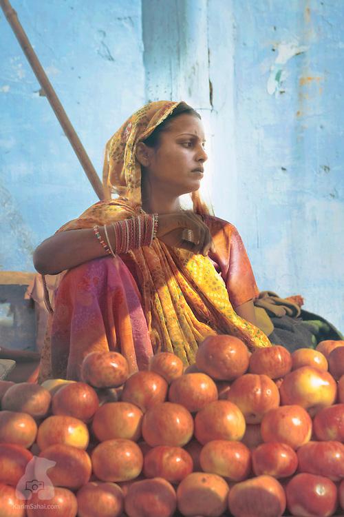 A woman selling apples, Pushkar, Rajasthan, India.