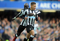 Football - 2017 / 2018 Premier League - Chelsea vs. Newcastle United<br /> <br /> Dwight Gayle of Newcastle celebrates his goal with Mohamed Diame, at Stamford Bridge.<br /> <br /> COLORSPORT/ANDREW COWIE