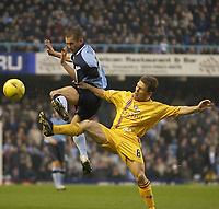 Picture: Henry Browne.<br />Date: 22/11/2003.<br />Coventry City v Gillingham Nationwide Division One.<br /><br />Michael Doyle of Coventry jumps up ahead of Gillingham's Andy Hessenthaler