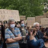 Demonstrators hold placards during a protest against racial inequality in the aftermath of the death in Minneapolis police custody of George Floyd, in front of the U.S. Embassy in Budapest, Hungary on June 20, 2020. ATTILA VOLGYI