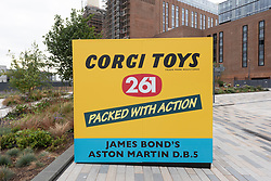 © Licensed to London News Pictures. 01/09/2021. London, UK. A life size Corgi toy box containing a replica of an Aston Martin DB5 is on display at The Coaling Jetty, Battersea Power Station in. London. The car marks the countdown to the cinema release of the delayed new Bond movie No Time To Die, starring Daniel Craig. The gadget laden replica replicates the original Corgi design is one of a limited number of DB5 'Goldfinger' Continuation cars costing £3.3 million each. Photo credit: Ray Tang/LNP