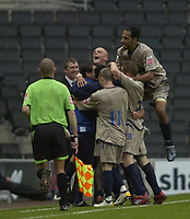 Photo: Matt Bright.<br /> Milton Keynes Dons v Stockport County. Coca Cola League 2. 27/10/2007.<br /> Jim Gannon Stockport Manager grins broadly as the team celebrate Anthony Eldings goal