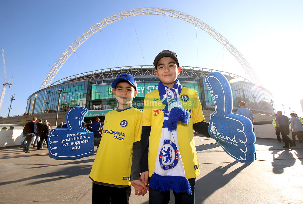 A general view of Chelsea supporters arriving at Wembley Stadium with Mind charity foam fingers prior to the beginning of the Carabao Cup Final at Wembley Stadium, London.