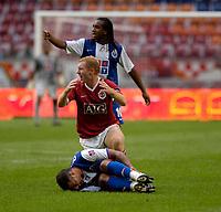 Photo: Daniel Hambury.<br />Manchester United v FC Porto. Amsterdam Tournament. <br />04/08/2006.<br />Manchester's Paul Scholes stands over Porto's Quaresma. Scholes was sent off for the challange.