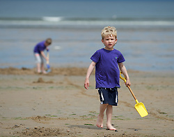 © Licensed to London News Pictures. 24/07/2012..Saltburn Beach, Cleveland, England..As temperatures rise visitors to the beach in the seaside town of Saltburn by the Sea in Cleveland enjoy their day. ..Albie Kingsbury, 5 enjoys the beach...Photo credit : Ian Forsyth/LNP