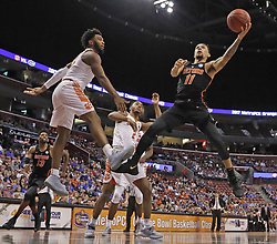 December 16, 2017 - Sunrise, FL, USA - Florida's Chris Chiozza (11) shoots in the second half against Clemson during the Orange Bowl Basketball Classic at the BB&T Center in Sunrise, Fla., on Saturday, Dec. 16, 2017. Clemson won, 71-69. (Credit Image: © Al Diaz/TNS via ZUMA Wire)