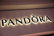 Sign for the clothing brand and accessory shop Pandora in Birmingham, United Kingdom.