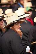 Amish man bids on farm equipment during the Annual Mud Sale to support the Fire Department  in Gordonville, PA.