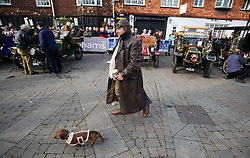 © under license to London News pictures. 07/11/2010. Chris Bates from Whitney, North Yors, walks his dog through Crawley town centre, West Sussex. Vintage four-wheeled cars, tricars and motor tricycles taking part in the 77th London to Brighton Veteran Car Run (LBVCR) pass through Crawley, West Sussex today (Sun). The world's longest running motoring even, representing 24 nations, takes the extraordinary automobiles on the 60-mile run from Hyde Park in central London to the seafront on the Sussex resort of Brighton.  Photo credit should read: London News Pictures/LNP