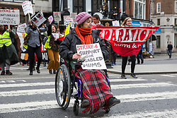 London, UK. 8th March, 2019. Women outside the Royal Courts of Justice take part in the International Women's Strike on International Women's Day to highlight the role of the High Court in separating mothers from their children, particularly mothers who are poor, single, of colour, immigrant, lesbian, disabled, fleeing domestic violence or sex workers.