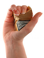 Model Released - Cigarette Packet Being Crushed by a Woman's Hand