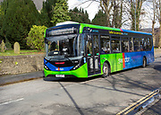 Single decker Swindon bus company vehicle in railway village area, Swindon, Wiltshire, England, UK