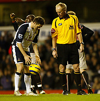 Photo: Chris Ratcliffe.<br />Tottenham Hotspur v Sunderland. The Barclays Premiership. 03/12/2005.<br />Robbie Keane (L) places the ball on the penalty spot before missing. Referee Phillip Walton watches on