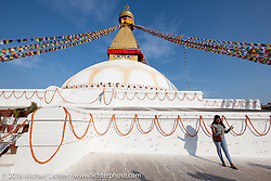 Nepalese tourist at Boudhanath Stupa in Kathmandu during our Himalayan Heroes adventure, Nepal. Saturday, November 3, 2018. Photography ©2018 Michael Lichter.