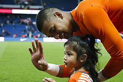 September 30, 2017 - Paris, France - Paris Saint-Germain's French goalkeeper Alphonse Areola is pictured with his daughter at the end of the French L1 football match between Paris Saint-Germain and Bordeaux at the Parc des Princes stadium in Paris on September 30, 2017. (Credit Image: © Geoffroy Van Der Hasselt/NurPhoto via ZUMA Press)