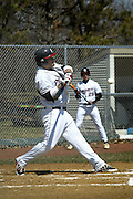 Brett Maloney '10 takes a high cut at a pitch during the Pioneers afternoon game against Central College at home as Greg Suryn '11 waits in the batters box.