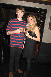 JOHN GUINNESS and EMMA DENNING at a leaving party for Poppy Delevigne who is going to New York to persue a career as an actress, held at Chloe, Cromwell Road, London on 25th January 2007.<br />