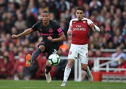 Everton's Richarlison (left) and Arsenal's Lucas Torreira (right)
