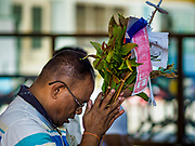 18 NOVEMBER 2017 - YANGON, MYANMAR:  A man prays at Sule Pagoda in central Yangon. Pope Francis is visiting Myanmar, September 27-30. It will be the first visit by a Pope to the overwhelmingly Buddhist nation. He will meet with the Aung San Suu Kyi and other political leaders and will participate in two masses in Yangon. The Pope is expected to talk about Rohingya issue while he is in Myanmar. The Rohingya are persecuted Muslim minority in Rakhine state in western Myanmar. It's not clear how Myanmar's politically powerful nationalist monks will react if the Pope openly talks about the Rohingya. In the past, the monks have led marches and demonstrations against foreign diplomatic missions when foreign ambassadors have spoken in defense of the Rohingya. There is not much visible sign of the Pope's imminent visit in Yangon, which is estimated to be more than 90% Buddhist.   PHOTO BY JACK KURTZ