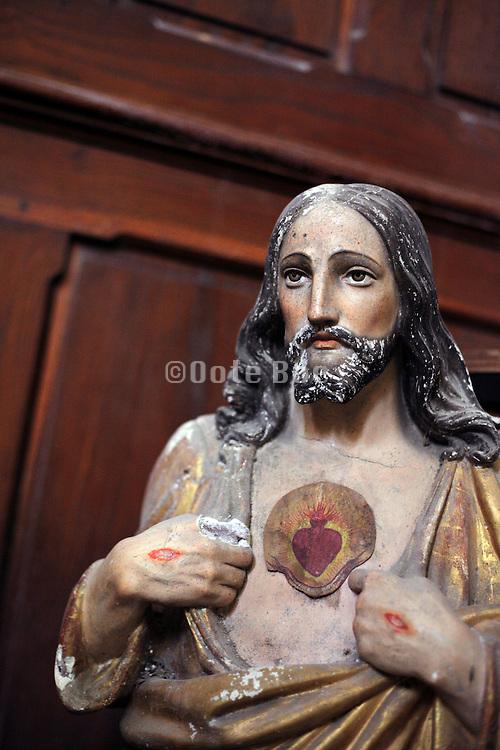 damaged religious sculpture of Jesus