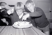 boys attacking a birthday cake for the picture 1960s