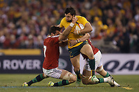 MELBOURNE, 29 JUNE - Adam ASHLEY-COOPER of the Wallabies is tackled by Sam WARBURTON, Captain of the Lions during the Second Test match between the Australian Wallabies and the British & Irish Lions at Etihad Stadium on 29 June 2013 in Melbourne, Australia. (Photo Sydney Low / asteriskimages.com)