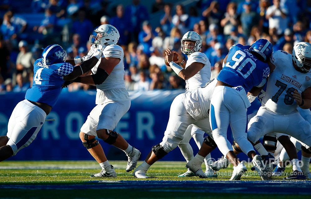 LEXINGTON, KY - SEPTEMBER 30: Brogan Roback #4 of the Eastern Michigan Eagles drops back to throw during the game against the Kentucky Wildcats at Commonwealth Stadium on September 30, 2017 in Lexington, Kentucky. (Photo by Michael Hickey/Getty Images) *** Local Caption *** Brogan Roback