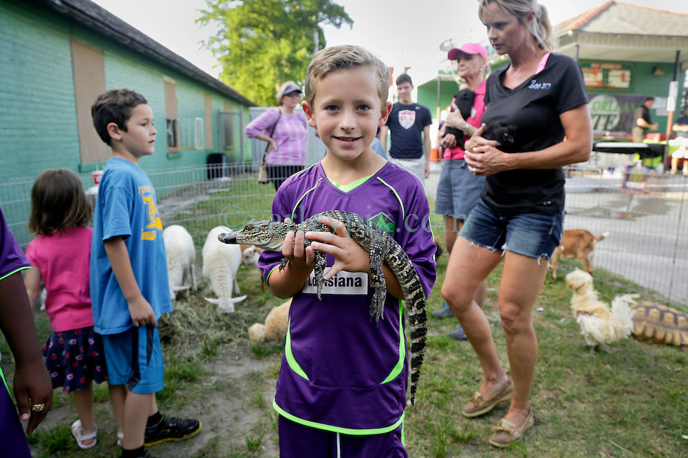 09 May 2015. New Orleans, Louisiana.<br /> Ben at the animal petting zoo for the New Orleans Jesters season opener at the Pan American Stadium against Jacksonville United. Jacksonville win 2-1 in a tense game.<br /> Photo; Charlie Varley/varleypix.com