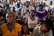 A group of Christians are attending Sunday morning mass at the local evangelical church 'Assembly of God', on the island of Sao Tome, Sao Tome and Principe, (STP) a former Portuguese colony in the Gulf of Guinea, West Africa.