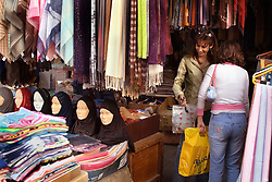 Unveiled women shop for clothes in an outdoor boutique in the mixed Shia and Sunni Muslim neighborhood of Tariq Jadida, in Beirut, Lebanon, March 23, 2006.